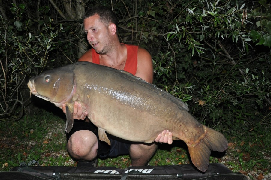 "Brad with ""the nude fish"" 42.11lb stock pond July 2013"