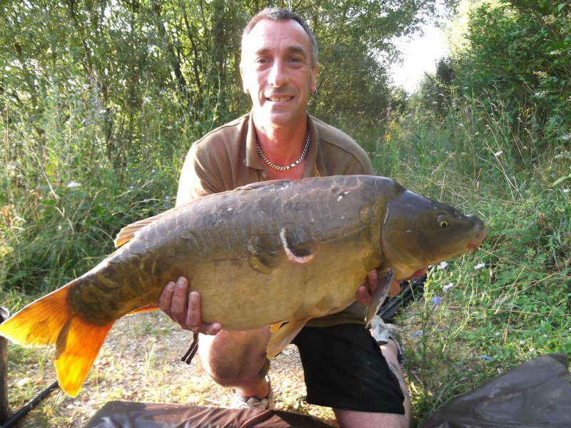 "Russ with ""the richmond fish"" 30.02lb, the tree line July 2013"