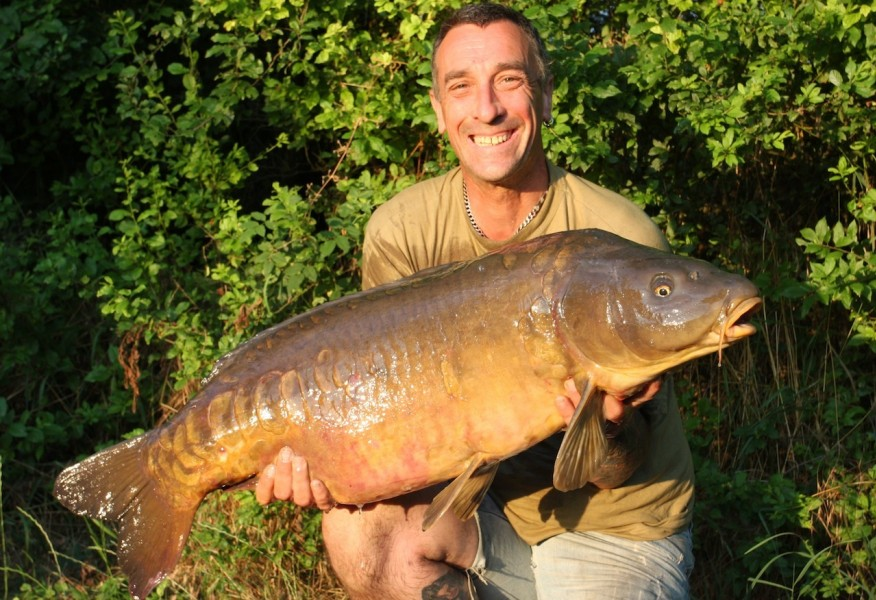 "Russ with ""the survivor"" 41.12lb, the tree line July 2013"