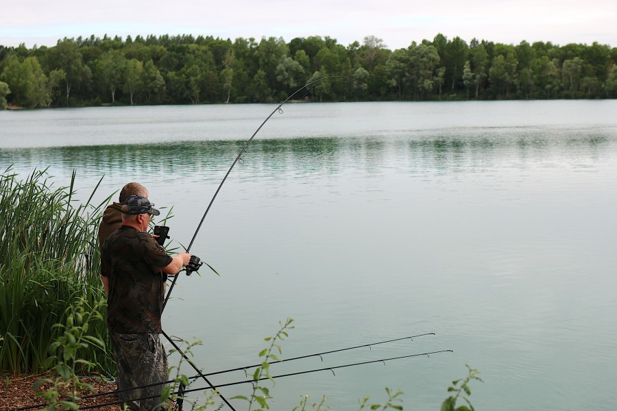 Andy in action with a good bend in the rod in Stock Pond.............