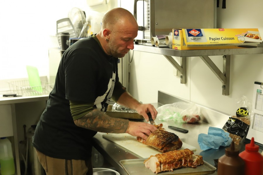 Chef Simon carving up the pork.